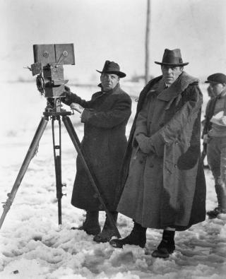 photo of director D.W. Griffith on location
